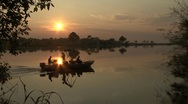 Stock Video Footage of Sunset at River with Boat passing by