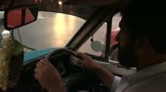 Inside a cab - Karachi taxi driver Stock Footage