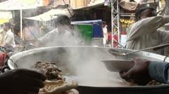 Pakistani streetlife behind freshly prepared food Stock Footage