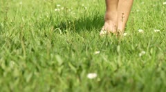 Woman walks in grass Stock Footage