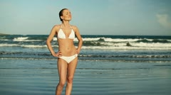 Portrait of sexy woman in white bikini on the beach, slow motion HD Stock Footage