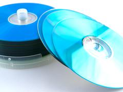 Cds dvds disks on white background Stock Photos