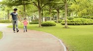Stock Video Footage of Father and son walking in the park together