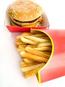 burger and fries in cardboard - stock photo
