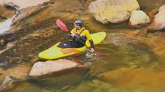 Yellow kayak in river rapids close up Stock Footage