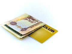 Five dirham note and gold membership club card on white background Stock Photos