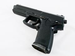 Black pistol handgun on white Stock Photos