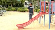 Stock Video Footage of Father and son playing on a slide