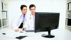 Hispanic Doctors Using Computer  Stock Footage