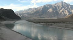 The majestic Indus river as it flows through the Karakoram Ranges - stock footage