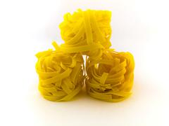 pasta tagliatelli on white background - stock photo