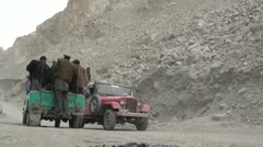 Passenger transport in the affected Attabad area in Northern Pakistan - stock footage