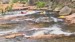 Kayakers in river rapids 04 Stock Footage