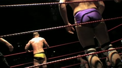 Professional Wrestler Dropkicked Out of Ring HD - stock footage