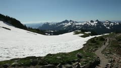 Claiming to the mount rainier Stock Footage