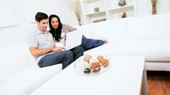 Hispanic Couple Home Wireless Laptop  Stock Footage