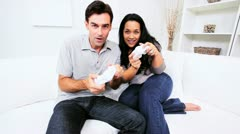 Ethnic Couple Playing Electronic Games  Stock Footage