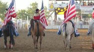 Stock Footage - 4 cowgirls on horse back, slow motion, American Flags Stock Footage