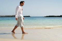 Man walking on beautiful tropical beach NTSC - stock footage