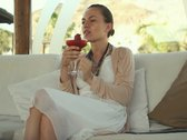 Happy young woman drinking exotic cocktail and relaxing NTSC Stock Footage