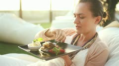 Happy woman eating sweet tasty dessert HD - stock footage
