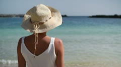 Woman in summer hat standing on beautiful tropical beach HD Stock Footage