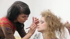 Young Woman Applying Makeup Stock Footage