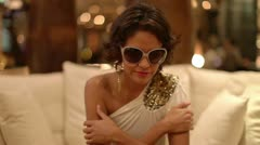 Beautiful model dances and poses luxury hotel Stock Footage
