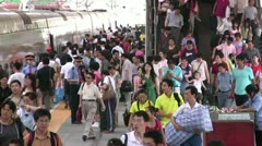 Passengers boarding a bullet train at Beijing Railway Station Stock Footage