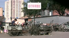 Parking bicycles in the suburbs of Beijing Stock Footage