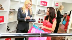 Female Shopper Credit Card Fashion Store  - stock footage