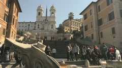 View of Rome, Italy with Spanish Steps, people, tourists, fountain and church Stock Footage