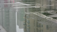 Reflection of a bicyclist riding by in China Stock Footage