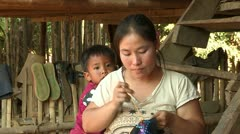 Thailand: Lahu Woman does Embroidery - stock footage