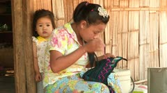 Thailand: Lahu Woman does Embroidery Stock Footage