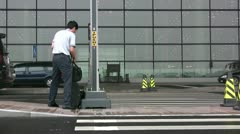 A Chinese businessman walks towards the entry of Beijing's airport Stock Footage