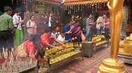 Stock Video of Thailand: Worshipers at a Buddhist Temple in Chiang Mai Stock Footage