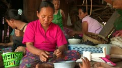 Thailand: Lahu Woman works by her Bamboo Home Stock Footage