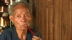Thailand: Smoking a Traditional Pipe Stock Footage