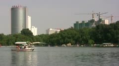 New office buildings and apartment blocks behind a lake in Beijing Stock Footage