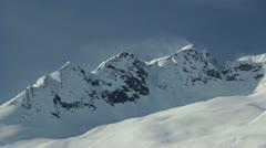 Wind  Blowing Snow Off Mountain Peak HD720 Stock Footage