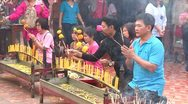 Stock Video of Thailand: Worshiping at the Temple Stock Footage