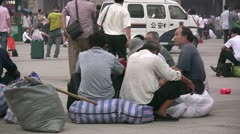 Chinese migrants wait for the train - stock footage