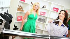 Female Friends Browsing Exclusive Clothing Store  - stock footage