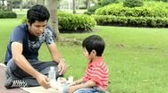 Stock Video Footage of Father and Son on a Picnic Together in the Park