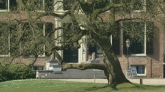 Medieval castle Rosendael 04p zoom out pond lawn Stock Footage