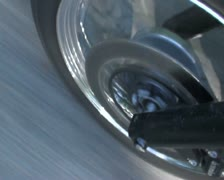 Motorcycle front tyre going fast shadows - SD PAL Stock Footage