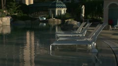 Monte Carlo Bay Hotel pool chairs Stock Footage