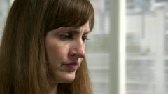 Close-up of a woman looking concerned. Stock Footage
