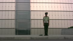 Guard in front of the 'National Centre for the Performing Arts' in Beijing Stock Footage